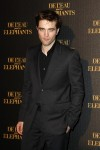 "Actor Robert Pattinson poses for pictures as he arrives at the French premiere of his movie ""Water for Elephants"" in Paris"