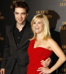 "Actor Robert Pattinson and actress Reese Witherspoon pose for pictures at the French premiere of his movie ""Water for Elephants"" in Paris"