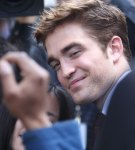 Robert Pattinson Spends Time With Adoring Fans On Arrival To 'Water For Elephants' Premiere