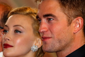 "Cast members Robert Pattinson and Sarah Gadon pose on the red carpet as they arrive for the screening of the film ""Maps to the Stars"" in competition at the 67th Cannes Film Festival in Cannes"